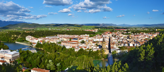 Panorama of Sanguesa city in Spanish Navarre. Aragon river and the city entrance via the bridge are at foreground