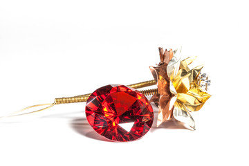 red ruby diamonds and golden flower on the white background