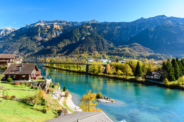 Beatiful river at Interlaken Switzerland in sunny day during autumn. Wall mural