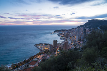 Panoramic view of Monte Carlo in the evening. The Principality of Monaco is situated on a prominent escarpment at the base of the Maritime Alps along the French Riviera.