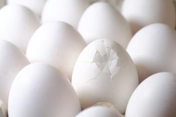 Cracked egg among all eggs