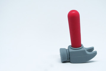 Selective focused, an image of toy hammer made from red and grey soft rubber isolated on white background.