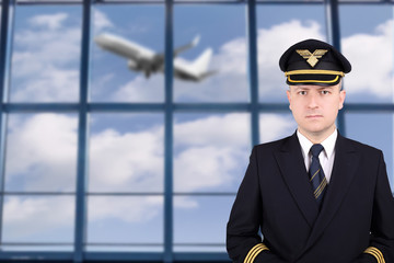 Captain in uniform at the airport