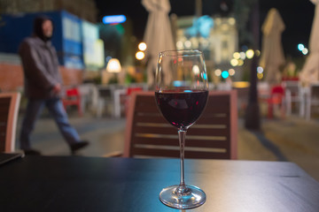 red wine glass on the table in the streets