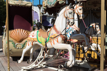 White horses of the antique carousel