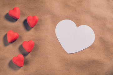 Red hearts on a brown paper background. Valentine's day