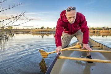 paddling canoe on calm lake