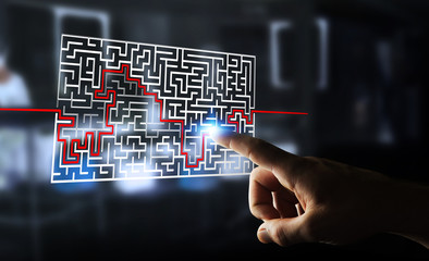 Businesswoman searching solution of a complicated maze