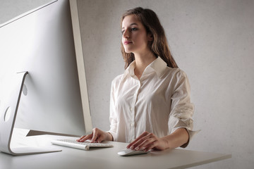 Employee sitting at her desk