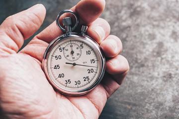 hand holding chronometer