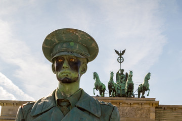 A lifelike doll of a German soldier at the Brandenburger Tor.