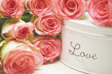 box with love text and pink roses