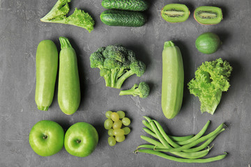 Many different fruits and vegetables on grey background