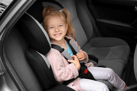 Cute girl on backseat in car