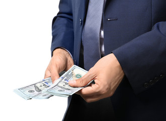 Businessman holding money on white background. Corruption concept