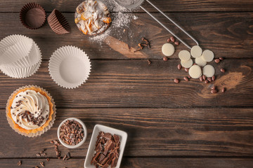 Composition with tasty pastries on wooden background
