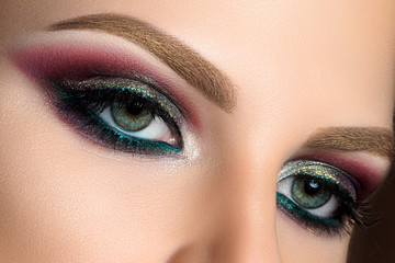 Close up of green woman eyes with fashion makeup