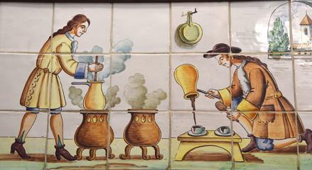 Männer bei der Küchenarbeit - Bild aus bemalten Fliesen in der Altstadt von Valencia