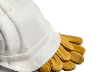 Construction Workers Hard Hat and Gloves on white background with copy space