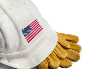 Construction Workers Hard Hat and Gloves showing badge of the  flag of the USA