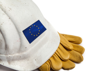 Construction Workers Hard Hat and Gloves showing badge of the  flag of the EU