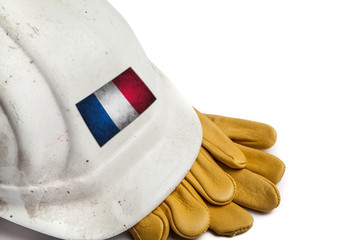 Construction Workers Hard Hat and Gloves showing badge of the  flag of France