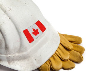Construction Workers Hard Hat and Gloves showing badge of the  flag of Canada