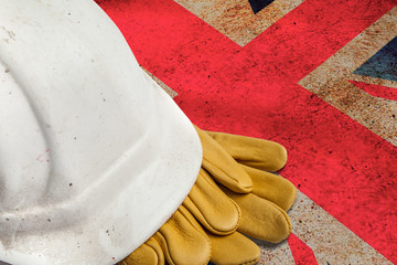 Construction Workers Hard Hat and Gloves on flag of Great Britain