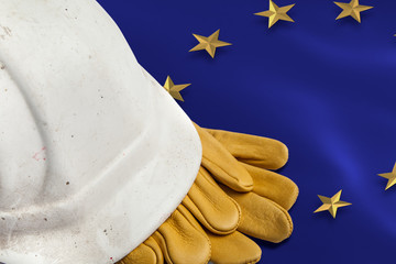 Construction Workers Hard Hat and Gloves on flag of the EU