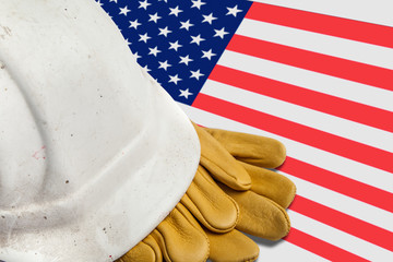 Construction Workers Hard Hat and Gloves on flag of USA