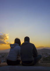 beautiful sunset with couple, panoramica de Cholula and popocatepetl volcano, view between friends, man and woman, man and man,
