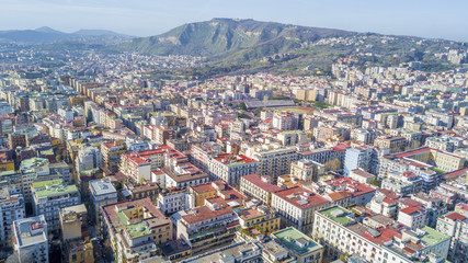 Aerial view of Naples from the Vomero district. The houses and palaces extend in the northern part of the city up to Mount Faito in the background.