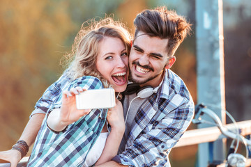 Happy adorable lovers posing for selfie photo