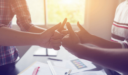 Good Business Concept,Thumbs up Business Partners Trust in Team Giving Fist Bump to Greeting Start up project Contractor.Businessman Teamwork are Partnership Team Meeting with Hands together.