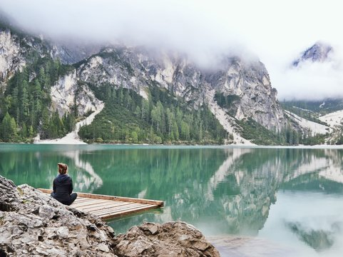 Person meditating on a lake