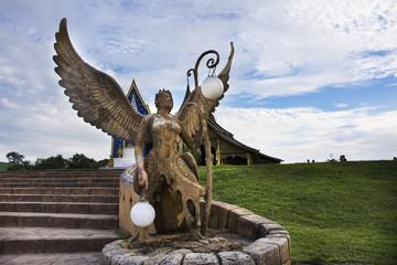 Kinnaree angel statue and lighting at Wat phu prao in Sirindhorn District in Ubon Ratchathani, Thailand