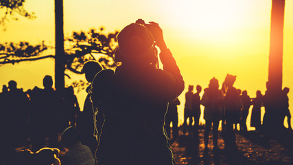 photographer Asian women Traveling photograph Nature. travel relax in the holiday. photograph sunrise in the morning among people. Thailand