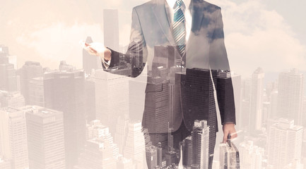 Handsome business man with overlay cityscape