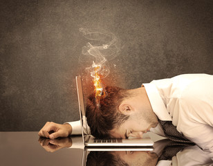 Sad business person's head catching fire
