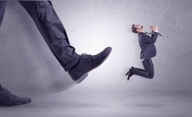 Foot kicking, businessman flying