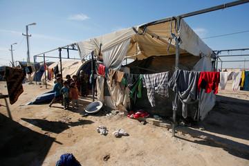 Displaced Iraqi children are seen at Amriyat al Fallujah camp in Anbar Province