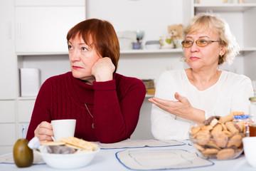 Two elderly women squabbling
