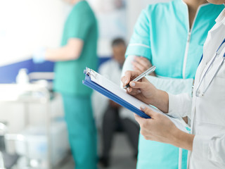 Doctors checking medical records