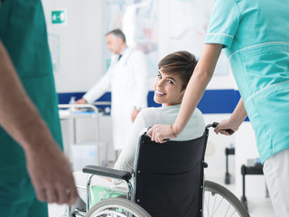 Smiling patient on wheelchair at the hospital