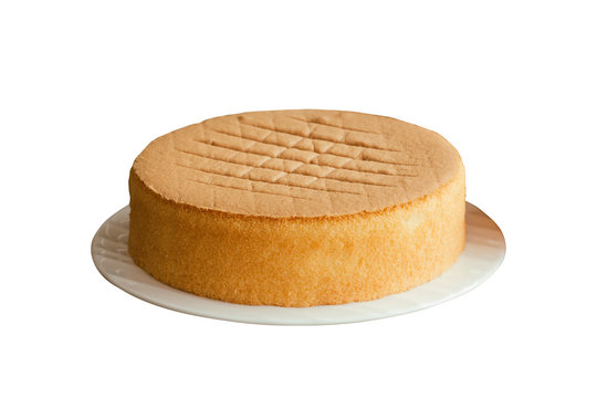 Homemade chiffon or sponge cake on white plate on white isolated background with clipping paths. Homemade bakery concept to present foam type cake so soft and lite good smell and delicious.