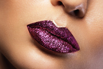 Female lips with glitters