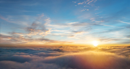 Beautiful aerial view above clouds with sunset Fototapete
