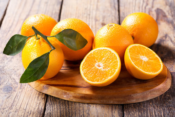 fresh orange fruits with leaves Wall mural