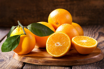 Poster Fruits fresh orange fruits with leaves