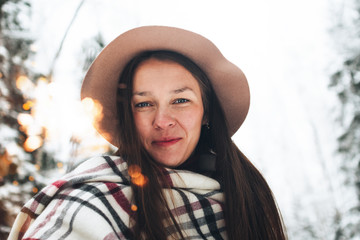Handsome and beautiful women have fun in winter with sparkler in hand. Cheerful female hipster hold bengal light in hand and enjoying winter holidays